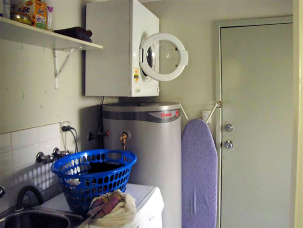 Laundry with washer and dryer, iron, etc